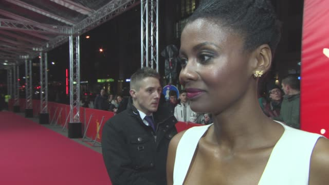 stockvideo's en b-roll-footage met interview emayatzy corinealdi on bring the film to the berlin film festival on don cheadle's passion bring the film together bringing the story to... - internationaal filmfestival van berlijn 2016