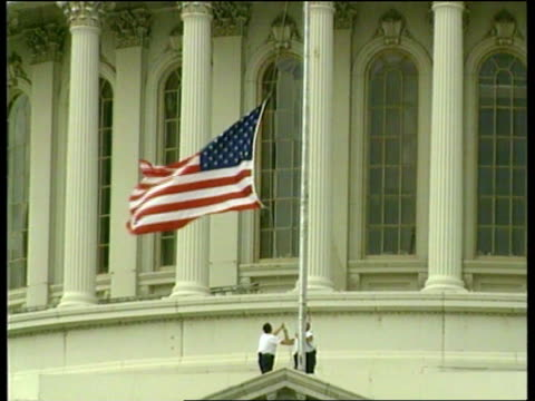 US Embassies bombed dNAT Washington Capitol Building LMS US flag Stars and Stripes being lowered to halfmast GV Capitol with flag at half mast White...