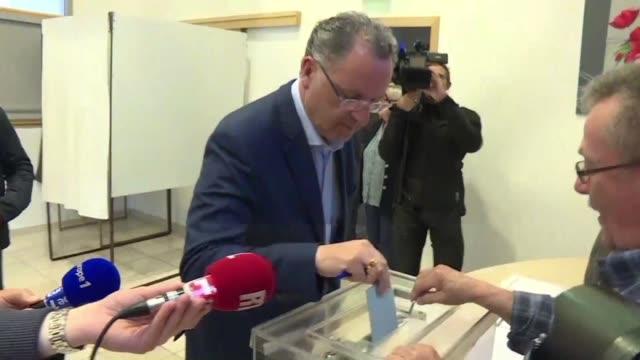 embattled french housing minister richard ferrand cast his ballott in his hometown of motreff in brittany - hometown bildbanksvideor och videomaterial från bakom kulisserna