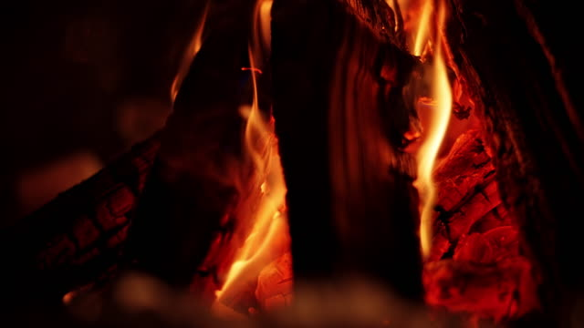slo mo ld embers in the campfire at night - flammable stock videos & royalty-free footage