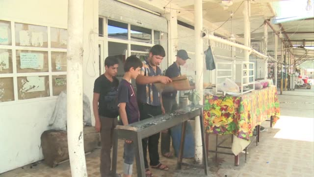 embittered and afraid iraqi christians in the town of bartala are pondering their fate just a short drive from militants and jihadists now in control... - 2014 bildbanksvideor och videomaterial från bakom kulisserna