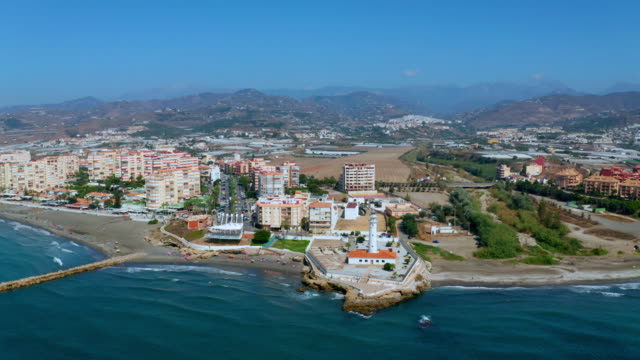 emblematic lighthouse & mediterranean sea, torrox, costa, spain - mittelmeer stock-videos und b-roll-filmmaterial