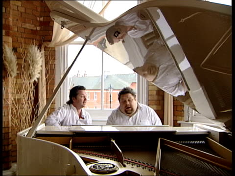 """'embrace' to perform england 2006 world cup song; london int martin bell and johnny spurling sit behind piano and perform song, """"sven, sven, sven""""... - internationaler fußball stock-videos und b-roll-filmmaterial"""
