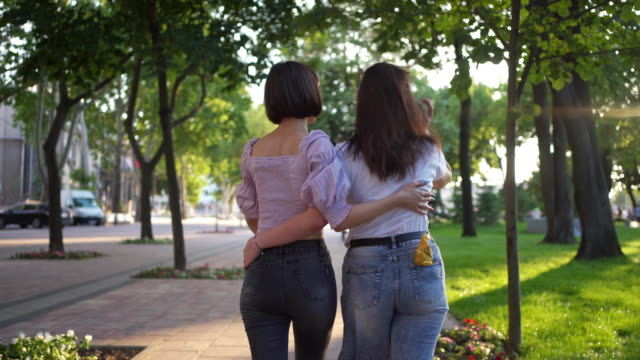 embraced young lesbian couple showing their love to the world - desire stock videos & royalty-free footage