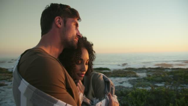 embracing during sunset - kapstadt stock-videos und b-roll-filmmaterial