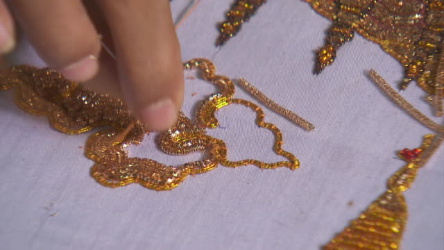 embroider with gold thread - embroidery stock videos & royalty-free footage