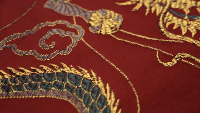 CU POV Embroidered silk dragon on red cloth / Singapore, Singapore, Singapore