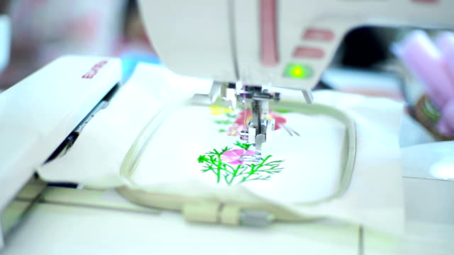 Embroidering flowers on a sewing machine.