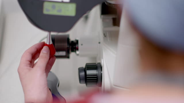 embryologists operate microscopes - human fertility stock videos & royalty-free footage