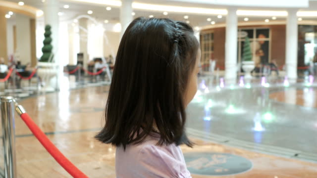 emcee broadcasting by Asian little girl