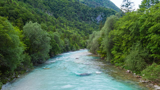 emerald river in lush green mountain valley - turquoise coloured stock videos & royalty-free footage