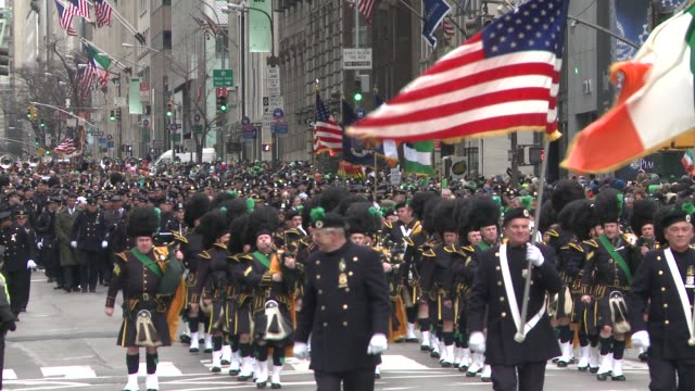 emerald society, new york city police department march down 5th ave. during the parade - st. patrick's day stock videos & royalty-free footage