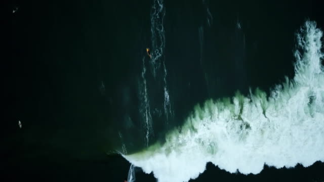 emerald-green waves crashing directly below drone - angle stock videos & royalty-free footage