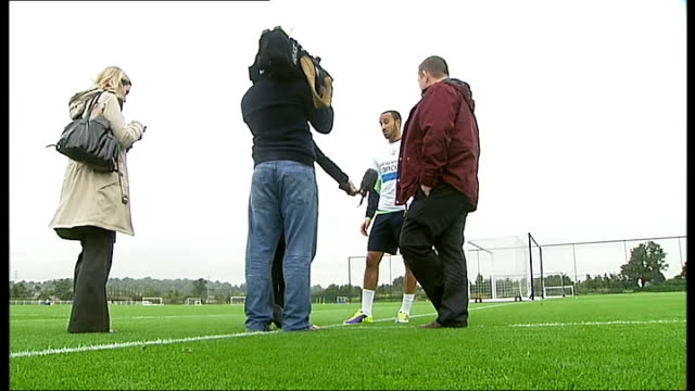 emergence of andros townsend / hodgson row andros townsend interview sot low angle view townsend being interviewed townsend chatting during interview... - nike designer label stock videos and b-roll footage