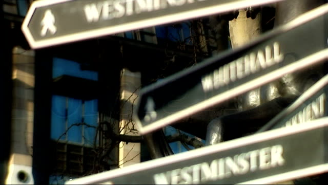 effects on londoners signs pointing to 'whitehall' and 'westminster' close up brass plaque outside foreign and commonwealth office hm treasury sign... - brass stock videos & royalty-free footage