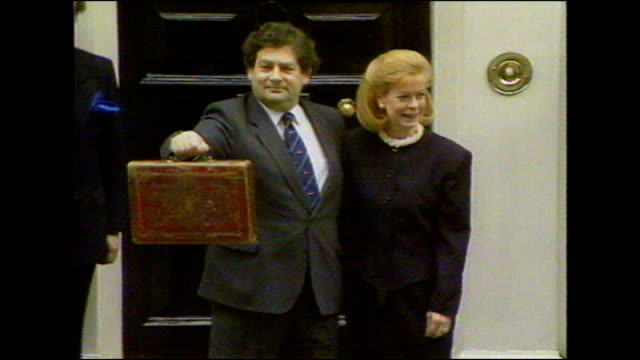 George Osborne says harsh spending cuts necessary LIB 1980's / 1990's ENGLAND London Downing Street EXT Geoffrey Howe MP photocall with budget box...