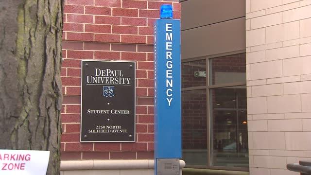vídeos de stock, filmes e b-roll de emergency button in front of depaul university on october 17 2013 in chicago illinois - sinal informativo