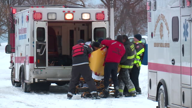 WGN Emergency Crews Rush Man Rescued From Frozen Lake Michigan to Ambulance at Belmont Harbor in Chicago on February 9 2018