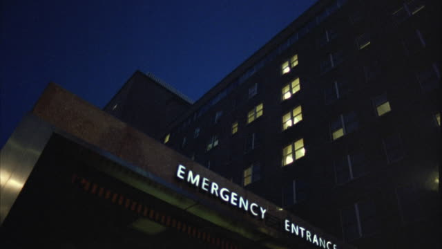 ms la emergency entrance of hospital at night - casualty stock videos & royalty-free footage