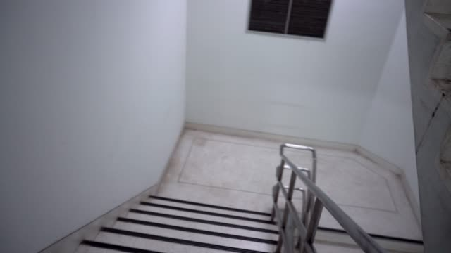 emergency fast walking pov downstairs - staircase stock videos & royalty-free footage