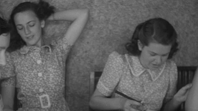 stockvideo's en b-roll-footage met montage emergency girls secondary school in the country having cooking and home economics classes during world war ii / united kingdom - home economics