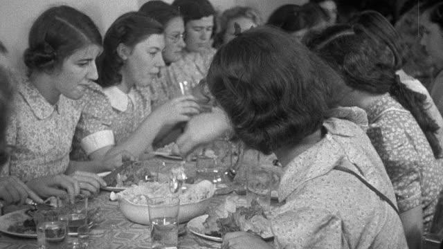montage emergency girls secondary school in the country having dinner together during world war ii / united kingdom - 1940 bildbanksvideor och videomaterial från bakom kulisserna