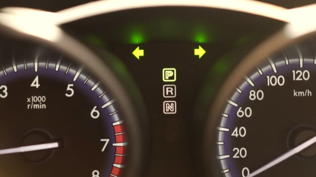 emergency lights at car tachometer. broken car showing emergency lights to notice others focusing at dashboard tachometer - dashboard stock videos & royalty-free footage