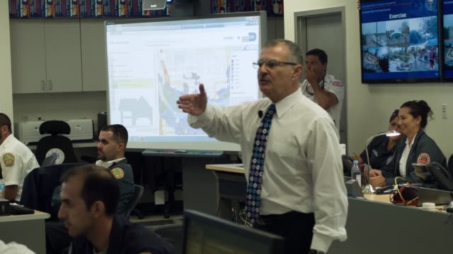 ls emergency officials take part in the annual hurricane emergency operations center functional exercise on may 28 2014 in miami florida with the... - notfallplan konzepte stock-videos und b-roll-filmmaterial