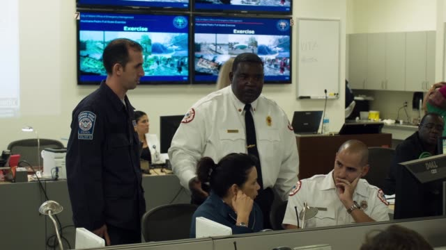 ls emergency officials take part in the annual hurricane emergency operations center functional exercise on may 28 2014 in miami florida with the... - emergency planning stock videos & royalty-free footage