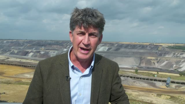 german villages bulldozed to make space for coal mine germany north rhinewestphalia ext reporter to camera at garzweiler opencast coal mine sot... - fossil fuel stock videos & royalty-free footage