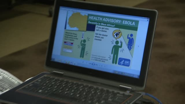 cdc emergency operations sign on glass door as well as ebola advisory graphics - bundesgesundheitsamt der usa stock-videos und b-roll-filmmaterial