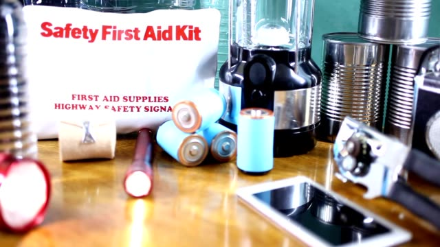 emergency preparedness natural disaster supplies.  water, flashlight, lantern, radio, batteries, first aid kit. - emergency planning stock videos & royalty-free footage
