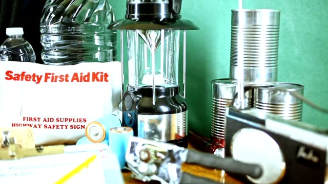 emergency preparedness natural disaster supplies.  water, flashlight, lantern, radio, batteries, first aid kit. - first aid kit stock videos & royalty-free footage
