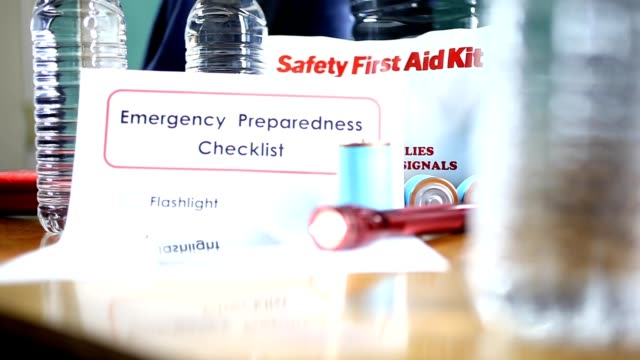 emergency preparedness natural disaster supplies.  water, flashlight, lantern, radio, batteries, first aid kit. - accidents and disasters stock videos & royalty-free footage