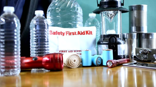 emergency preparedness natural disaster supplies.  water, flashlight, lantern, radio, batteries, first aid kit. - accidents and disasters stock videos and b-roll footage