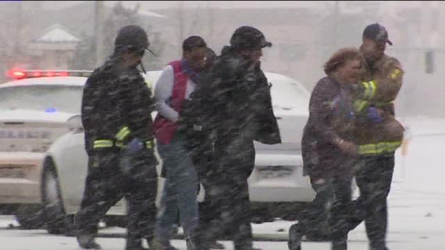 kdvr emergency responders with civilians on scene after colorado springs planned parenthood shooting on november 27 2015 in colorado springs colorado - clinic stock videos and b-roll footage