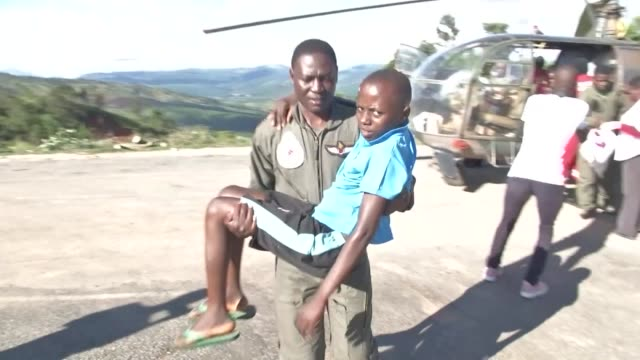 emergency response teams in zimbabwe use helicopters to help get cyclone survivors to safety - vortex stock videos & royalty-free footage