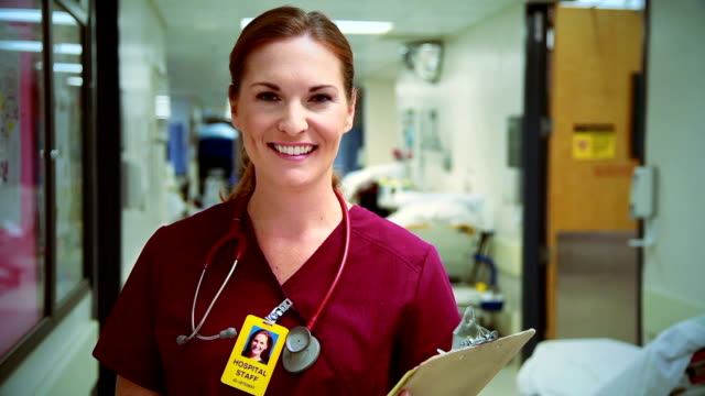 emergency room nurse smiles - scrubs stock videos & royalty-free footage