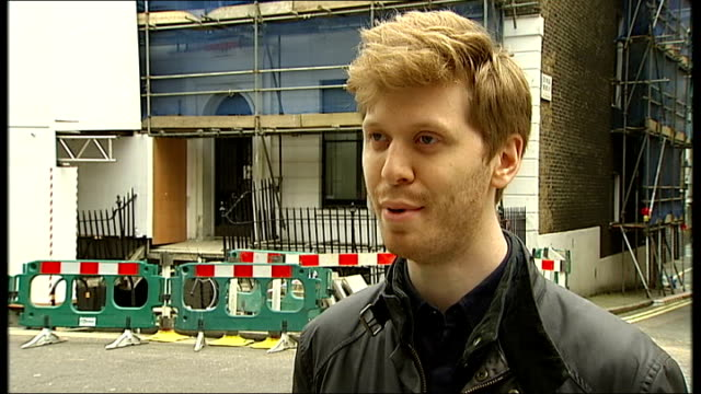 emergency service make scaffolding safe in marylebone gregory richters interview sot cutaway collapsed street paving - メリルボーン点の映像素材/bロール