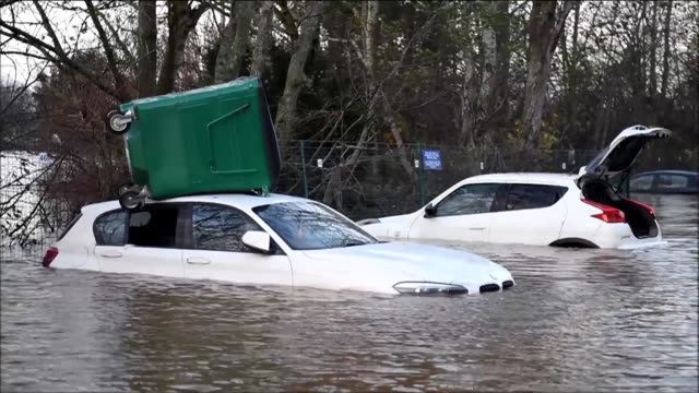emergency service workers wade through knee high floodwaters rescuing residents from their homes in the aftermath of storm desmond which left tens of... - northwest england stock videos and b-roll footage