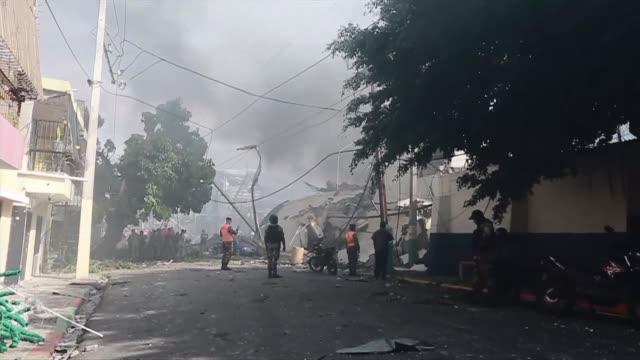 emergency services and police arrive on scene where three people were reported dead and dozens more injured after an explosion in a plastics factory... - santo domingo dominican republic stock videos & royalty-free footage