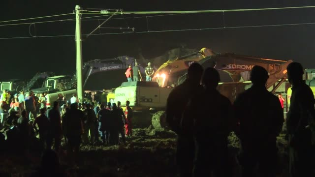 emergency services and railway technicians work at the site of a train crash in tekirdag turkey on july 09 2018 the train carrying 362 passengers and... - 編集動画点の映像素材/bロール