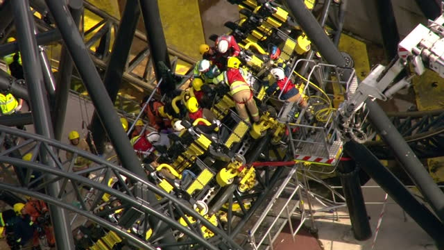 emergency services at alton towers crash sixteen people were in the carriage on the amusement park's 'smiler' ride when it crashed into an empty... - fahrgeschäft stock-videos und b-roll-filmmaterial