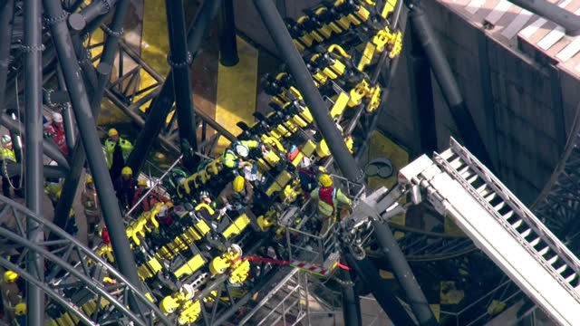 emergency services at alton towers crash. sixteen people were in the carriage on the amusement park's 'smiler' ride when it crashed into an empty... - 2015 stock-videos und b-roll-filmmaterial