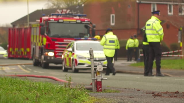 emergency services at house in stafford where four children died in house fire - 商業車点の映像素材/bロール