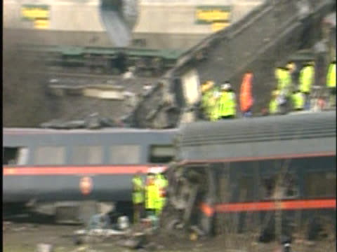 emergency services attend to the wrecked carriages of the train on the tracks following the selby rail crash - train crash stock videos and b-roll footage