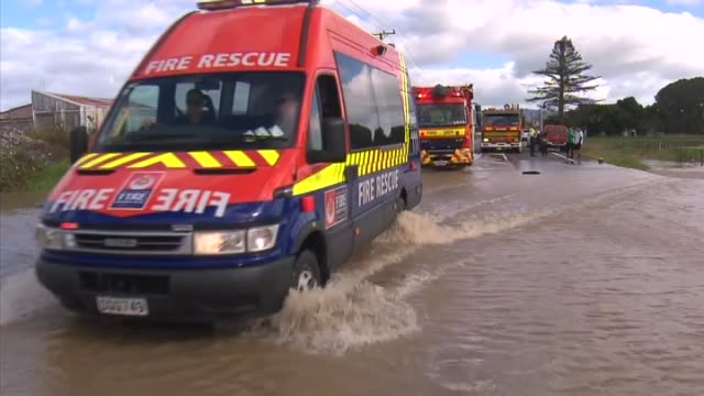 emergency services in attendance during severe flooding in town of edgecumbe with police blockade at town entrance, civilians driving and walking... - extreme weather stock videos & royalty-free footage