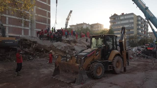emergency services personnel search an eight-story collapsed building for survivors after a powerful earthquake struck on november 01, 2020 in izmir,... - kara sea stock videos & royalty-free footage