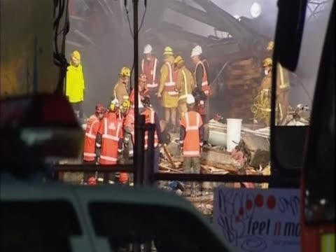emergency services tend to the destruction caused by the christchurch earthquake - christchurch stock-videos und b-roll-filmmaterial