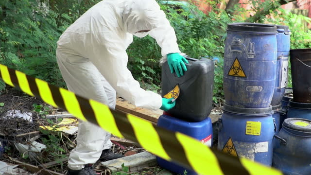 emergency team checking biohazard leak - environmental cleanup stock videos and b-roll footage